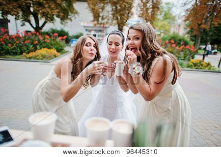Young Bridesmaid With Bride Drinking Coffee