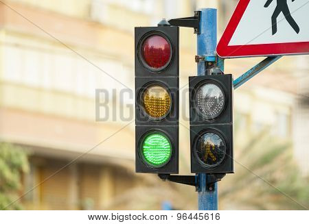 Traffic Light Closeup With Burning With Green Light