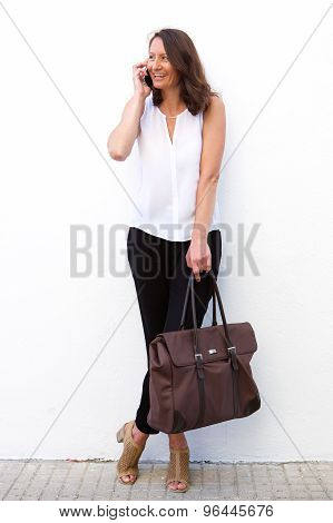 Modern Woman With Bag Using Mobile Phone