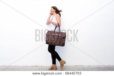 Happy Woman Walking With Bag And Mobile Phone