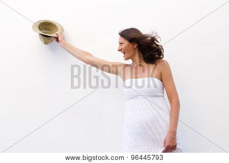 Cheerful Older Woman Holding Hat