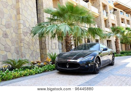Dubai, Uae - September 9: The Luxury Maserati Granturismo Car Is Near Luxurious Hotel On September 9