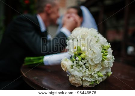 Wedding Bouquet On Wooden Table Background Newlyweds