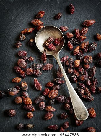 Dried Rose Hips Berries On A Dark Background