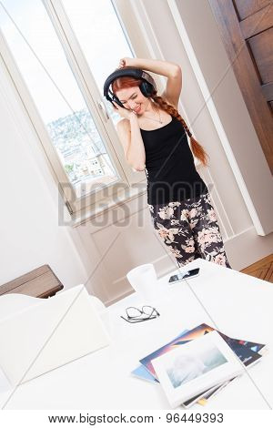 Woman Dancing While Listening Music On Headphone