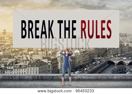Break the rules, words on blank board hold by a young girl in the outdoor.