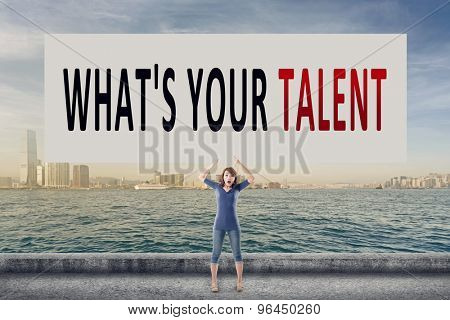 What's your talent, words on blank board hold by a young girl in the outdoor.