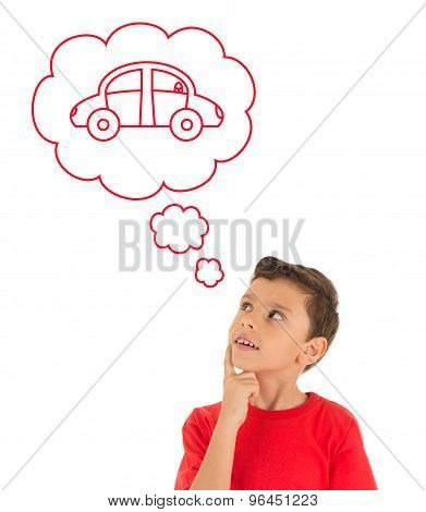 Young Boy looking up and dreaming with a car