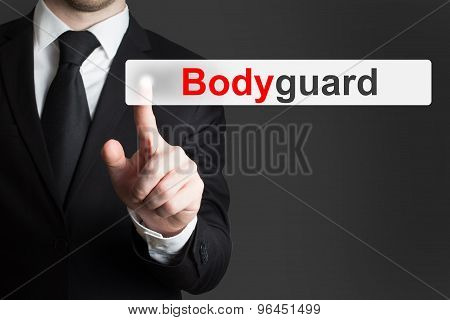 Businessman In Suit Pushing Flat Touchscreen Bodyguard