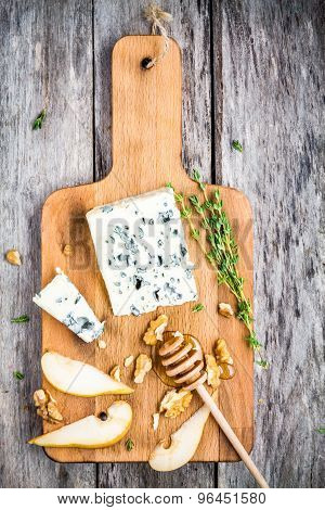 Blue Cheese With Slices Of Pear, Nuts And Honey