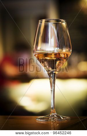 Glass Of Rose Wine On Bar Counter