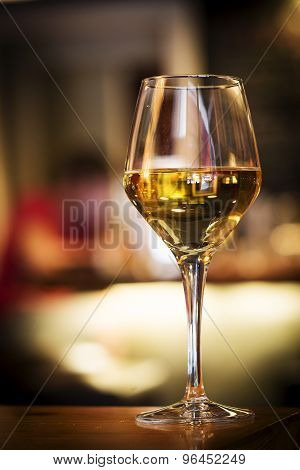Glass Of White Wine On Bar Counter
