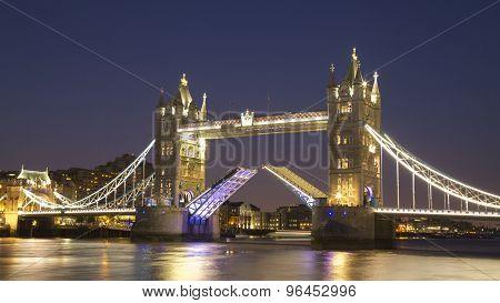 Tower Bridge raised at night