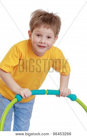 Funny boy playing with a Hoop