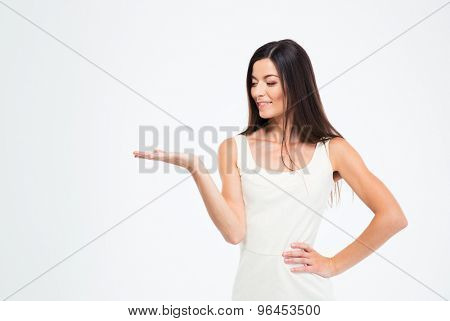 Smiling slender woman presenting copyspace on the palms isolated on a white background