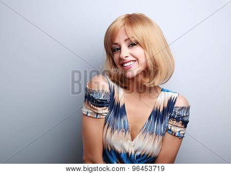 Beautiful Blond Happy Woman Toothy Smiling In Blue Dress