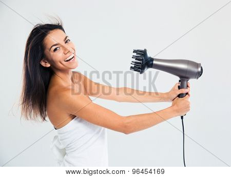 Laughing woman in towel drying her hair isolated on a white background