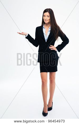 Full length portrait of a happy businesswoman holding copyspace on the palm isolated on a white background
