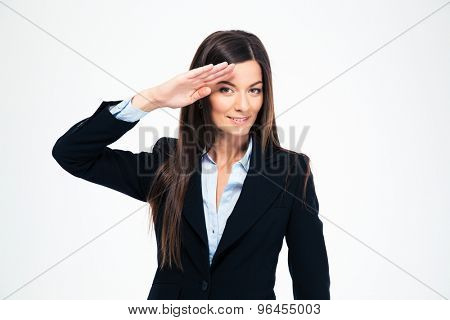Happy attractive businesswoman saluting isolated on a white background. Looking at camera