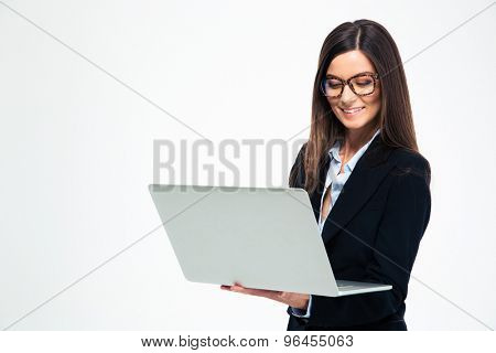 Smiling businesswoman using laptop isolated on a white background