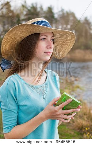 Freckled Girl In Hat Standing With Note And Looking Away