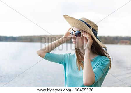 Freckled Girl Looking Through Glasses Of Lake