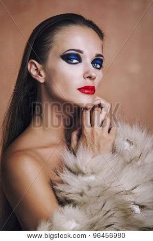 Beauty Fashion Model Girl In In A Fur Coat And Lingerie.
