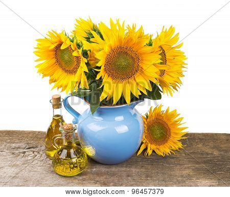 composition with sunflowers and sunflower oil on wooden desk