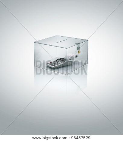 calculator in acrylic cube