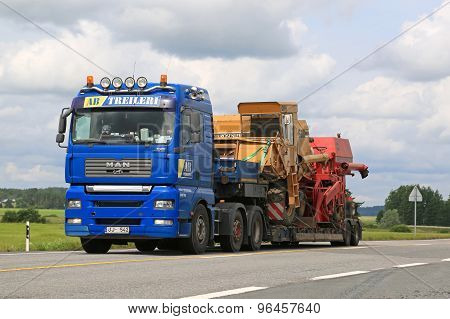 Man Truck Hauls Two Combine Harvesters