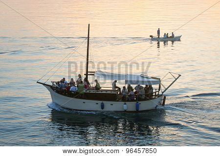 Boats Sailing At Sunset