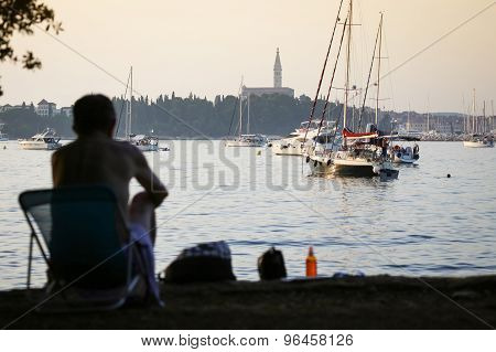 Man Sitting In Chair On Adriatic Coast