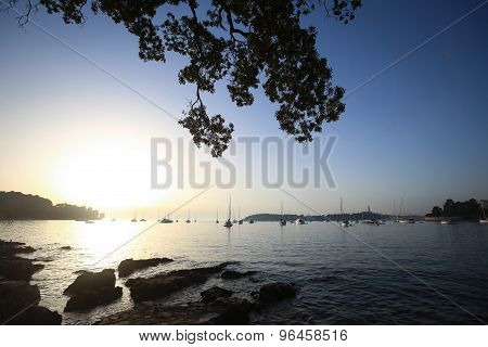 Sailboats At Sunset Anchored In Adriatic Sea