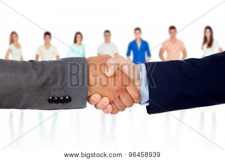 Handshake  between businessmen with unfocused people of background