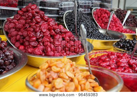 Bowls Of Traditionally Dried And Processed Sour Plums Cherries And Forest Fruits
