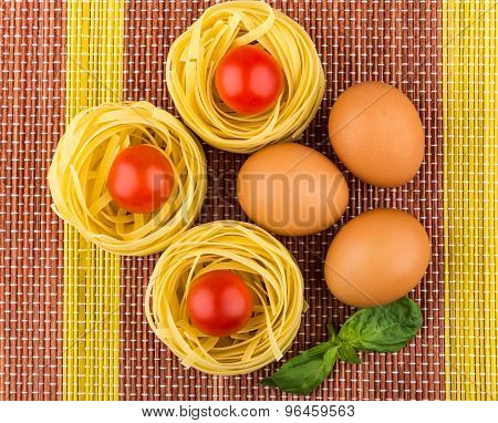 Tagliatelle, Tomatoes And Eggs On Mat
