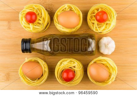Fettuccine With Tomatoes, Eggs, Garlic And Olive Oil In Bottle