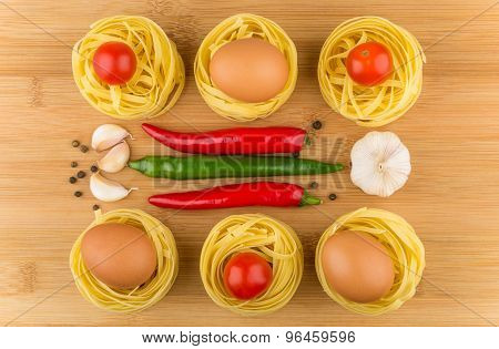 Fettuccine With Tomatoes, Eggs, Garlic And Chili Peppers On Board