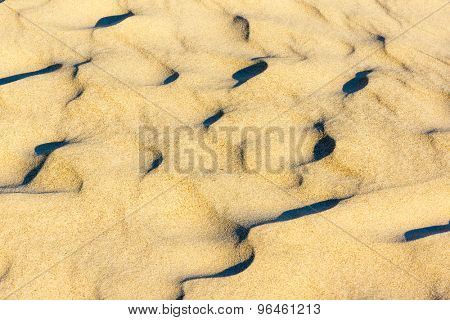 Wavy texture of sand on the dunes