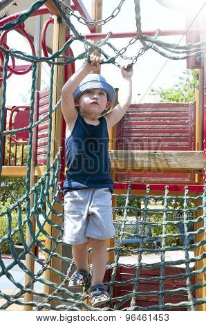 three-year boy playing on the playground