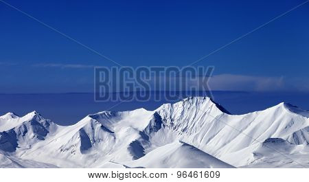 Snowy Mountains At Sunny Day. Panoramic View