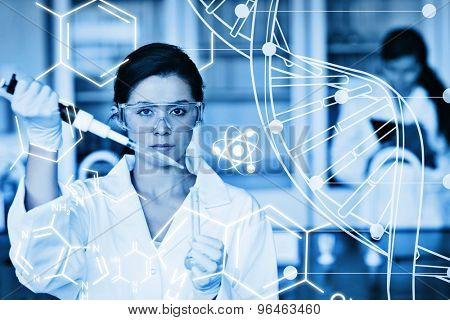 Serious chemist working with white dna helix diagram inteface against science graphic