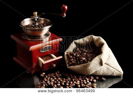 Sack Full Of Coffee Beans With Mill