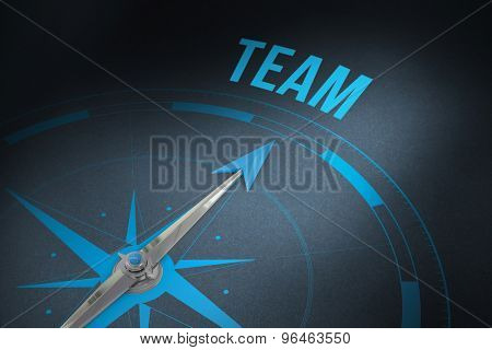 The word team and compass against grey