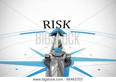 The word risk against compass arrow