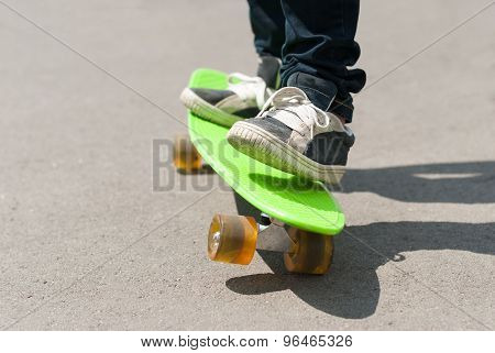 Skateboarder Riding A Skateboard.