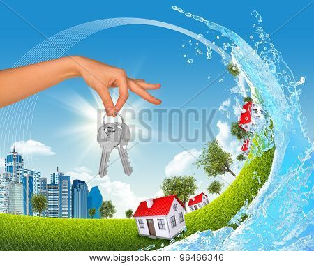 City inside ocean wave with hand and keys