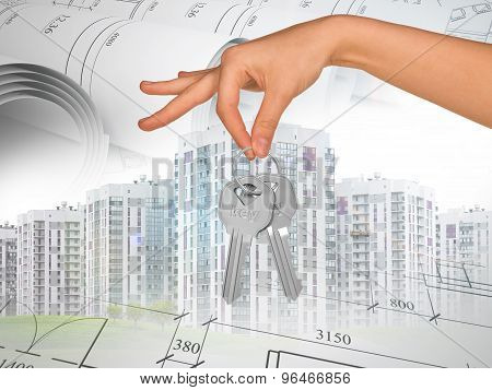 Buildings with hand holding keys