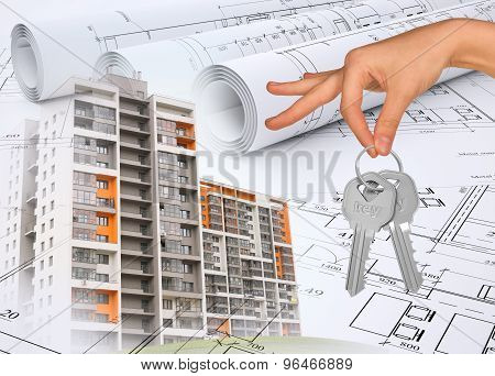 Buildings with hand holding keys and drafts