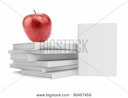 Fresh apple on pile of white books